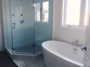 Bathroom renovation with custom frameless shower enclosure